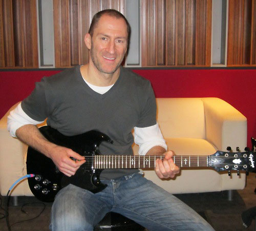 Cash Cab's Ben Bailey Rocks With An Epiphone Tony Iommi G-400