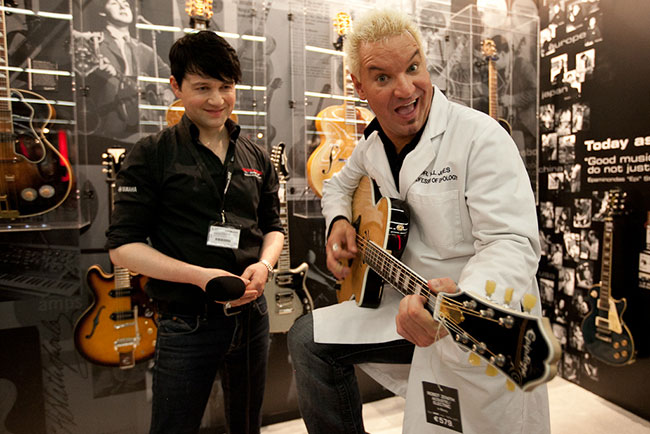 Epiphone's Will Jones talks about the exciting new Zenith Robot with a member of the media.